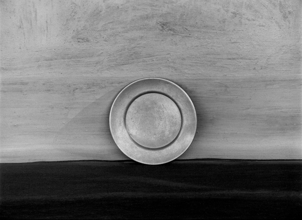 the circle of simplicity. Plate outside a house. Village Devgaon, 2008. 40 x 55 cms (approx.) S/W Hahnemühle Papier.  ©Manoj Kumar Jain/courtesy UTMT